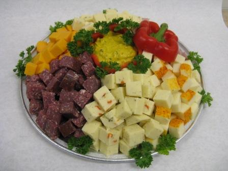 Cheese and meat cube tray with spicy mustard dip in the center.