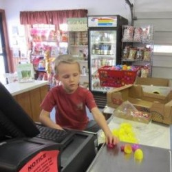 One little Weaver helping to fill Easter eggs!