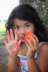 Girl eating peaches